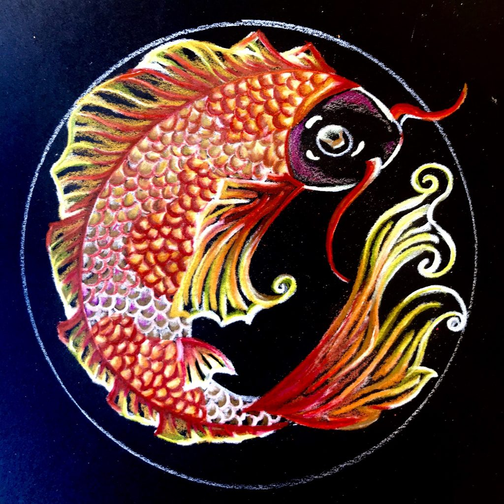 Mandala on black paper. Koi fish in yellow, orange, and red.