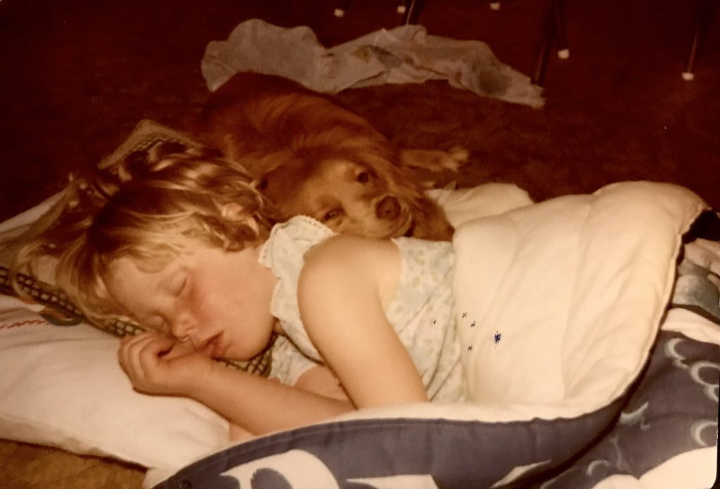 Anna sleeping at around 5 years of age with her dog.