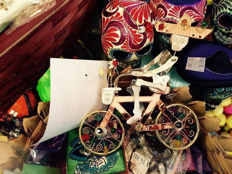 A skeleton ornament rides a bike with many textures in the background. In honor of the Day of the Dead. Photo by Anna Loscotoff.