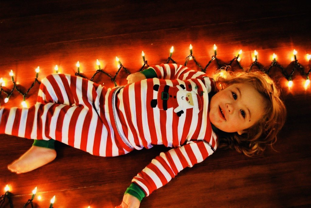 My daughter lays with Yule lights, 2007